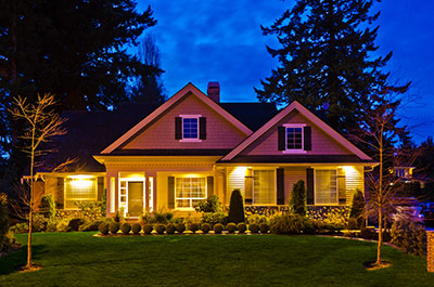 Exterior accent lighting on a home at night