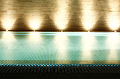 Exterior lighting around a swimming pool